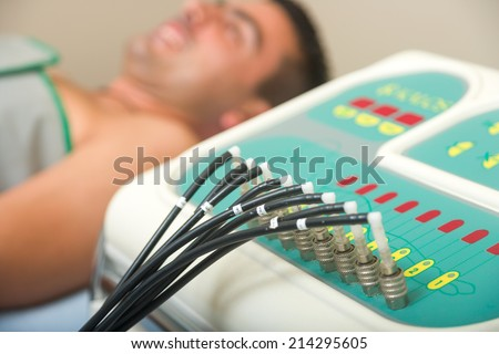 Man receiving an electro therapy at the health center - stock photo
