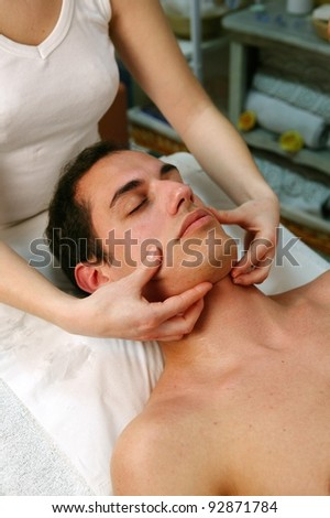 Man receiving face massage - stock photo