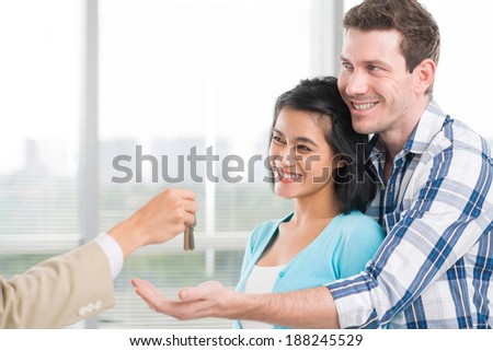 Man receiving keys from the broker - stock photo
