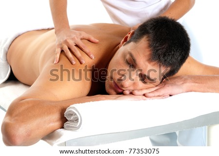 Man receiving massage relax treatment close-up from female hands - stock photo