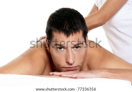 Man receiving massage relax treatment close-up  portrait from female hands - stock photo