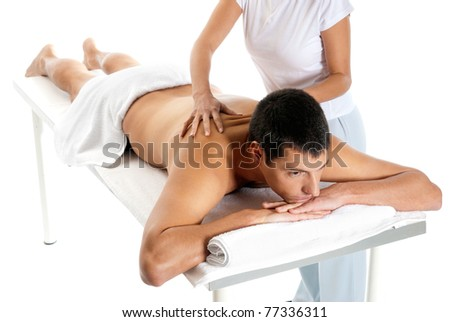 Man receiving massage relax treatment from female hands - stock photo
