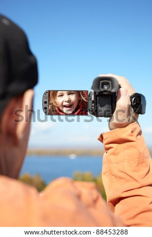 man recording with  camera, focus on the screen - stock photo