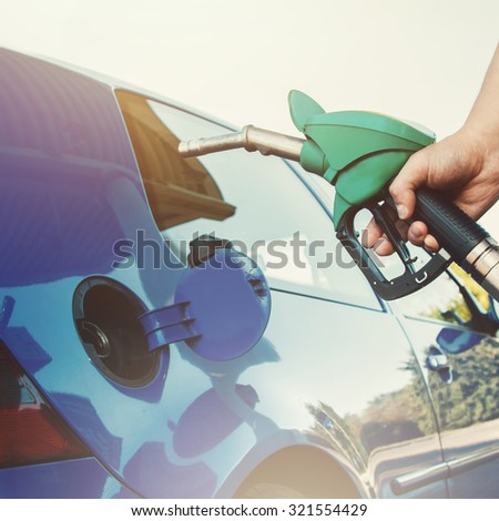 Man refuel his car on gas station - stock photo