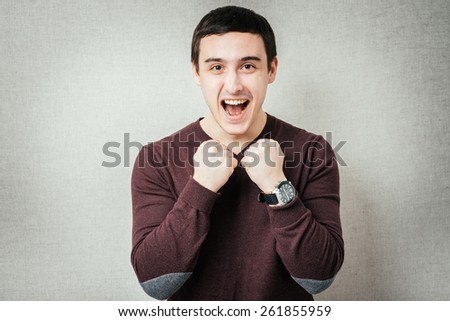 man rejoices victory with cams - stock photo