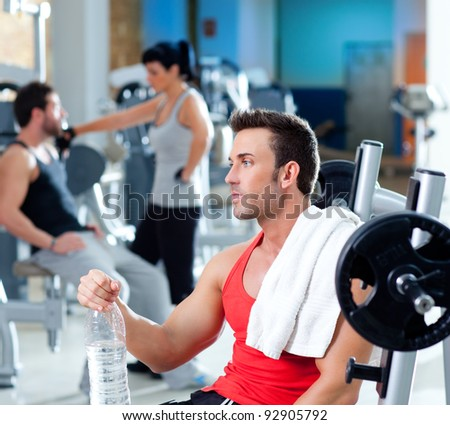 man relaxed on gym after fitness sport training with water bottle - stock photo