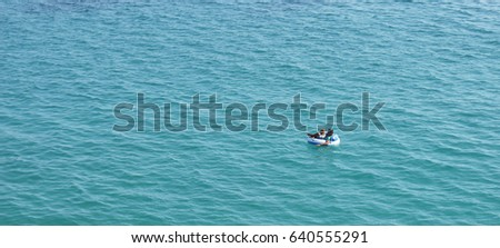Man relaxing at the air mattress in the sea