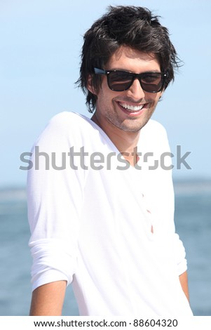 Man relaxing by the sea - stock photo