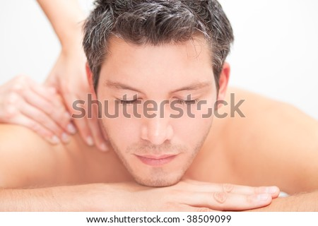 Man relaxing comfort getting neck back massage - stock photo
