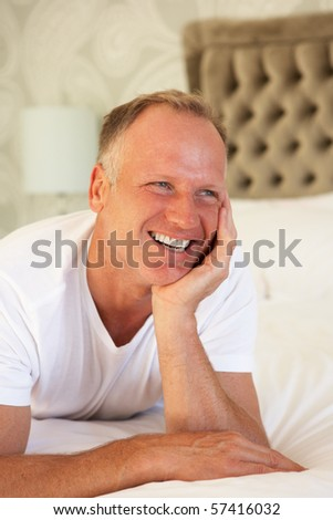 Man Relaxing In Bedroom - stock photo
