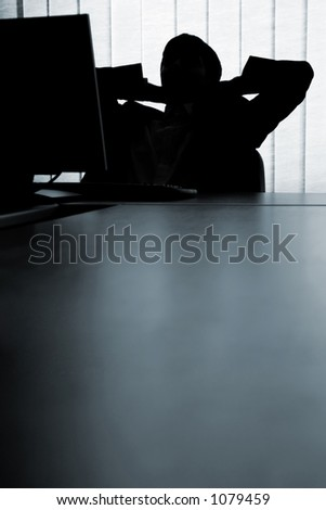 Man relaxing in front of the computer - stock photo