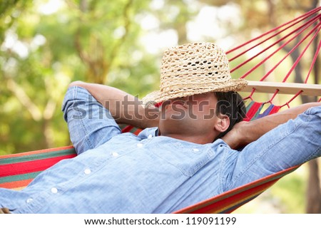 Man Relaxing In Hammock - stock photo