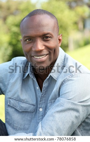 Man relaxing in public park - stock photo
