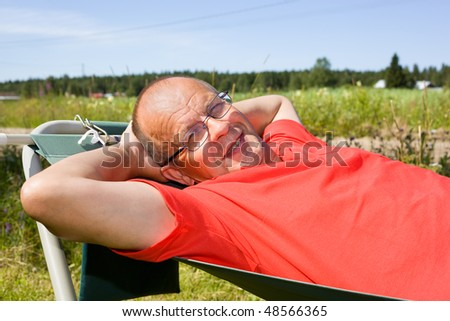 Man relaxing on hammock - stock photo