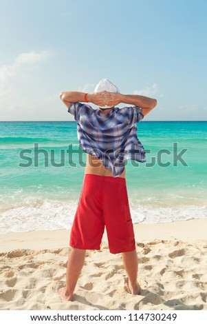 Man relaxing on holiday at Caribbean Sea
