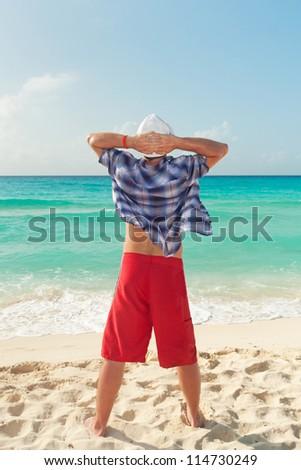 Man relaxing on holiday at Caribbean Sea - stock photo
