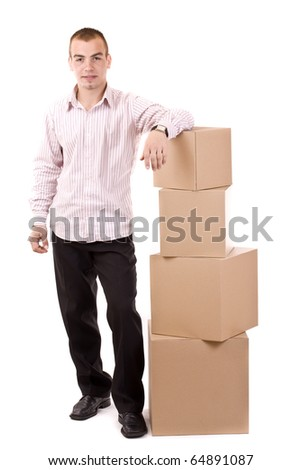 Man relaxing on lots of cardboard boxes - stock photo