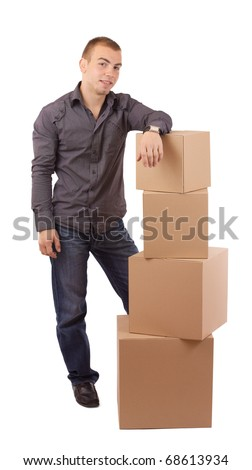 Man relaxing on lots of cardboard boxes