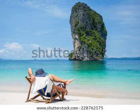 Man relaxing on the beach in Thailand