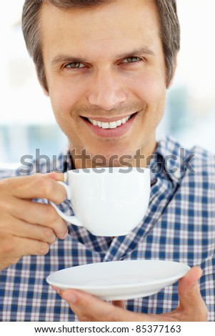 Man relaxing with cup of tea