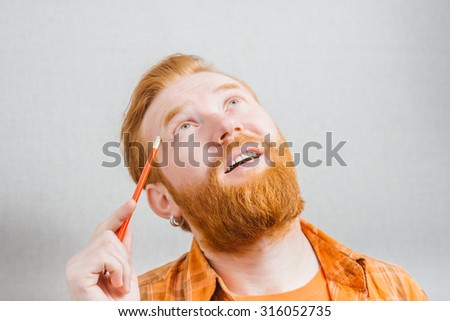 man remembers with a pencil in hand - stock photo