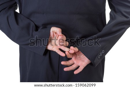 Man removing marriage ring from his finger behind his back isolated on white background.