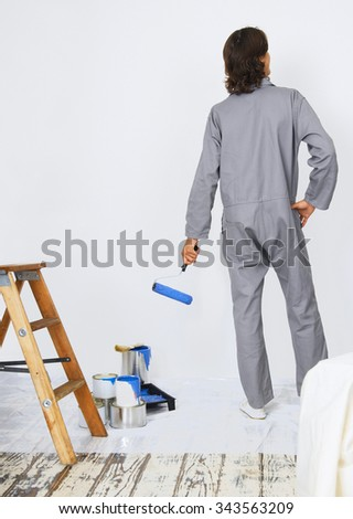 man repair, building and home concept - stock photo