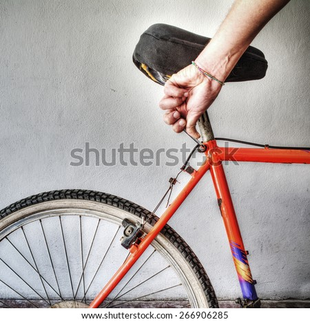 man repairing a mountain bike in a workshop. Processed for hdr tone mapping effect - stock photo