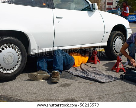 man repairing by himself his car - stock photo