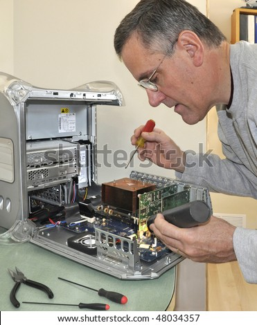 Man repairing computer - stock photo