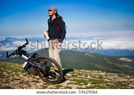 Man resting after cycling ascent