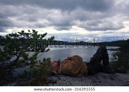 man resting in a hike