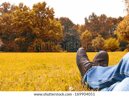 man resting in autumn - stock photo