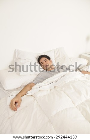Man resting in his bed
