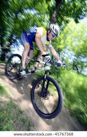 man ride his mountain bike - stock photo