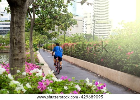 Man rides an exercise in public garden,Exercise for healthy