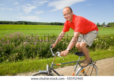 Man riding a bicycle on a funny way - stock photo