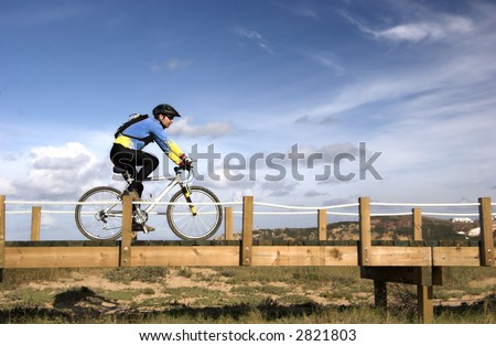 Man riding a bike in a beautiful day - stock photo