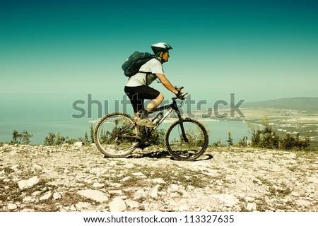 Man riding a bike on the mountain - stock photo