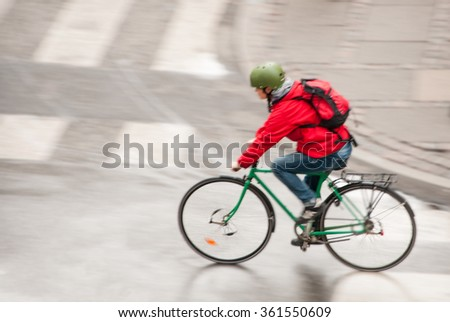 Man riding a bike on the street - stock photo