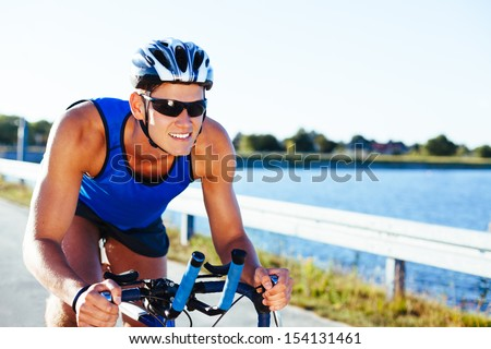Man riding bike - stock photo