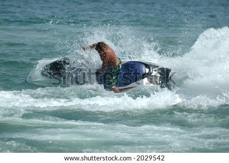 Man riding his jet-ski - stock photo