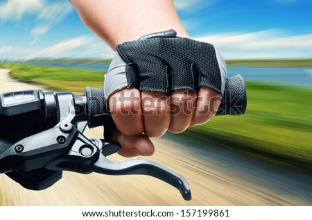 Man riding on a bicycle in a meadow, motion blur - stock photo