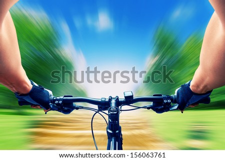 Man riding on a bicycle very fast, motion blur - stock photo
