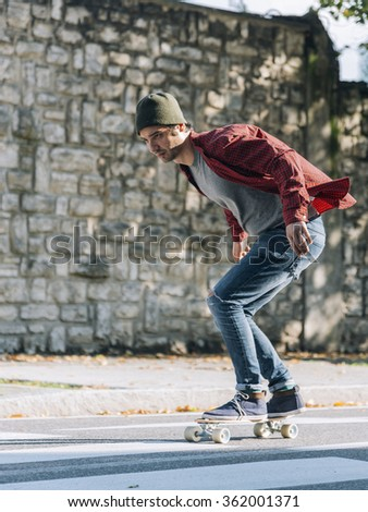 man riding on a skate in the city street - stock photo
