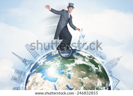 "Man riding unicycle around the globe with major cities concept, ""Elements of this image furnished by NASA"" - stock photo"