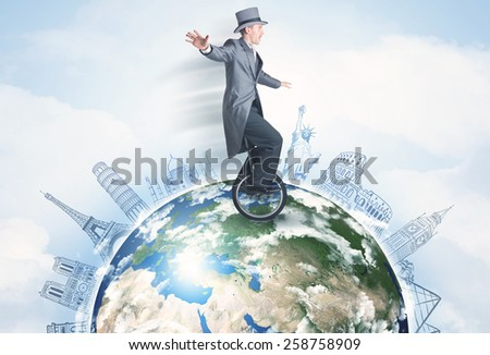 "Man riding unicycle around the globe with major cities concept,  ''Elements of this image furnished by NASA"""" - stock photo"
