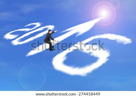 Man riding white 2016 year arrow up sign shape clouds with raised finger pointing direction on sunlight sky background
