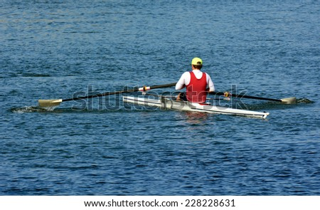 Man Rowing, Canoeing, Kayaking a kayak over river. - stock photo
