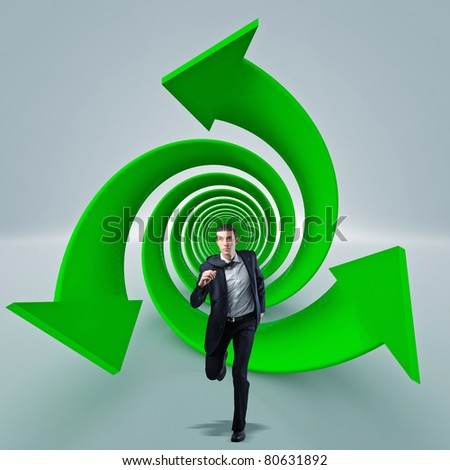 man run into 3d recicle tunnell - stock photo